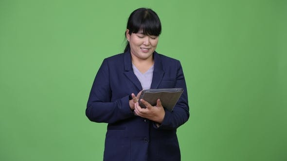 Thumbnail for Asian Businesswoman Using Digital Tablet