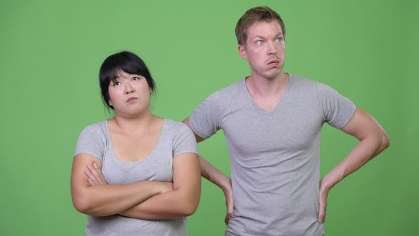 Thumbnail for Young Multi-ethnic Couple Looking Bored Together
