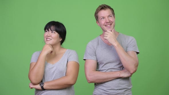 Thumbnail for Young Happy Multi-ethnic Couple Thinking Together