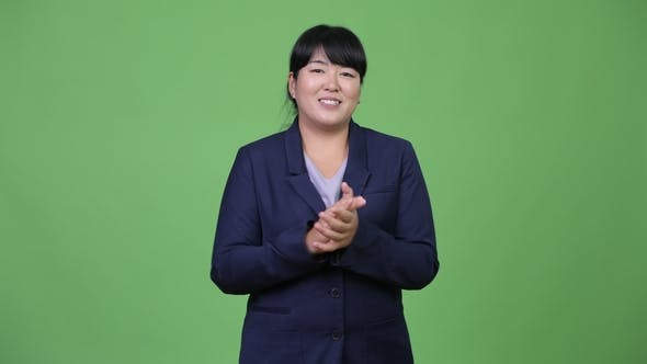 Thumbnail for Happy Overweight Asian Businesswoman Clapping Hands
