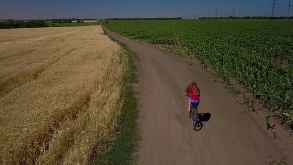 Thumbnail for Girl Riding a Bicycle