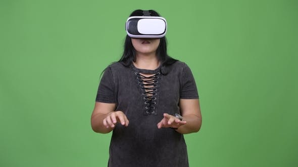 Thumbnail for Beautiful Overweight Asian Woman Using Virtual Reality Headset
