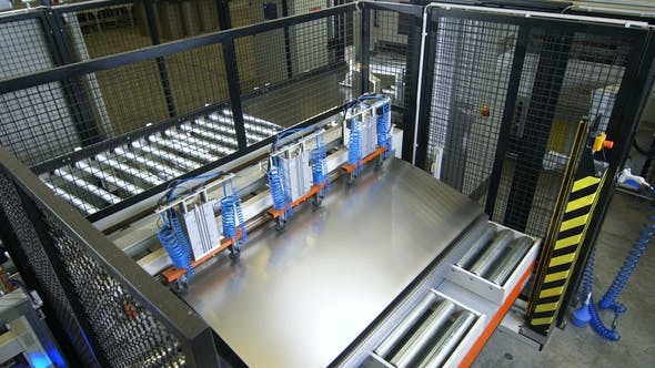 Upper View Automatic Machine Takes and Transports Metal Pieces