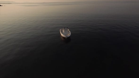 Thumbnail for Aerial View of Empty Boat in Quiet Sea at Sunset