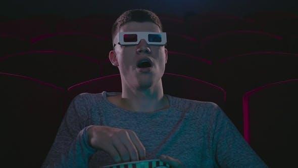 Thumbnail for Man in 3d Glasses Eating Popcorn Wathing Cinema