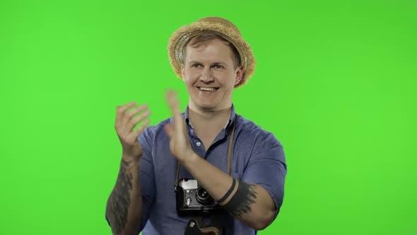 Portrait of Man Tourist Photographer Clapping Hands. Chroma Key