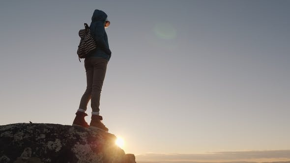 Thumbnail for A Successful Active Woman Stands on Top of a Mountain with Endless Horizons