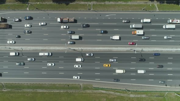 Thumbnail for Cars on Highway in City in Sunny Summer Day. Aerial Vertical Top-Down View