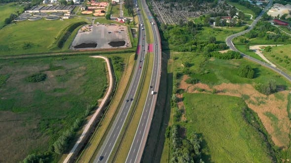 Aerial View Of A Freeway. Descending Shot Cars Driving By the Road. Traffic on the Highway