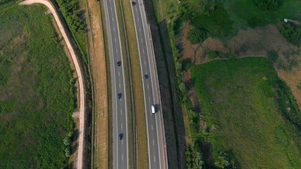 Aerial Vertical Shot. Cars Driving By the Road. Traffic on the Highway