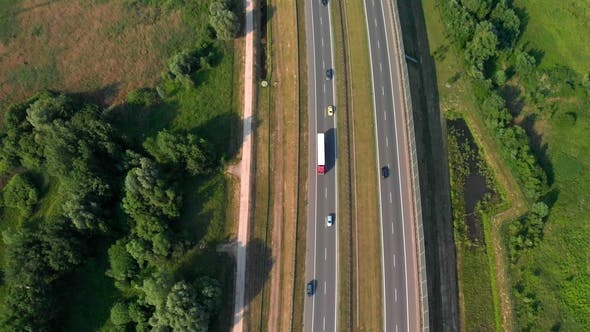 Thumbnail for Aerial Vertical Shot. Cars Driving By the Road. Traffic on the Highway