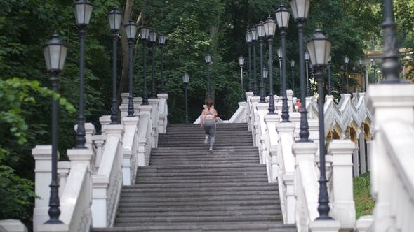 Thumbnail for Athletic Woman Running Up the Stairs in the Park
