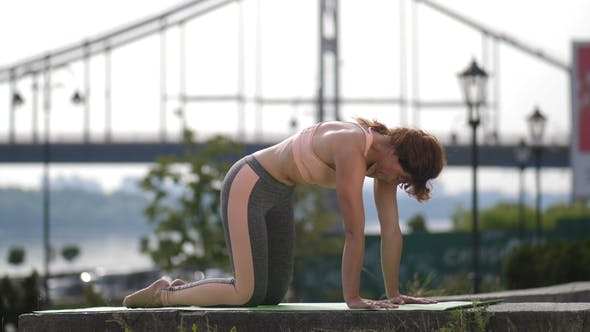 Thumbnail for Female Doing Bird Dog Stretching Excercise in City