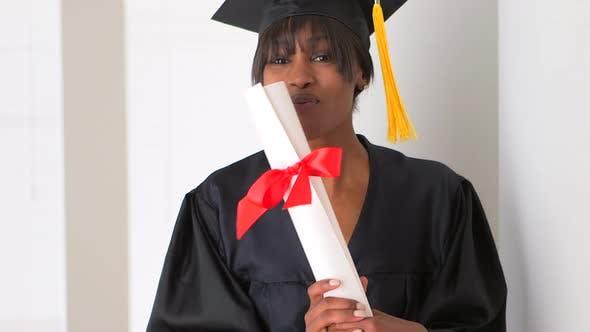 Happy black woman college graduate