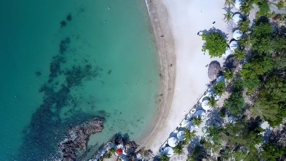 Thumbnail for Camera Descends Close To Ocean and White Sand Beach