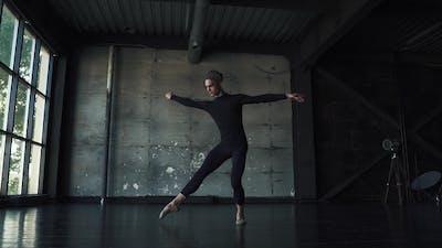Male Ballet Dancer Dancing Classical Ballet in a Dark Studio.