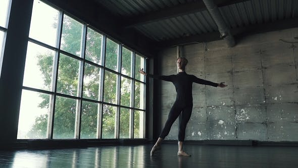 Thumbnail for Young Male Ballet Dancer Dancing in Studio on a Dark Background