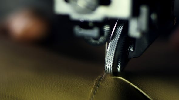 Thumbnail for Tailor Working on Sewing Machine at Textile Factory