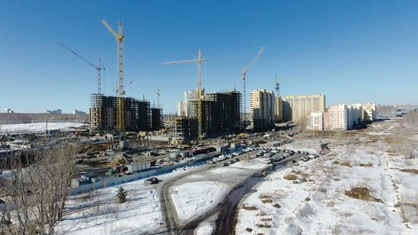 Thumbnail for Construction of a New Residential Area in Front of Road Traffic Covered in Snow