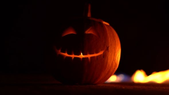 Thumbnail for Scary Smiling Symbol Jack-o-lantern Facial Expressions on Center of Frame. Head of Pumpkin in Hell