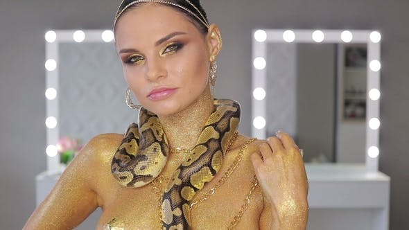 Thumbnail for Woman with Body Art Holding Snake