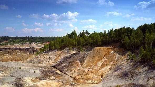 Thumbnail for Aerial Flight Along Steep Slopes of Clay Quarry
