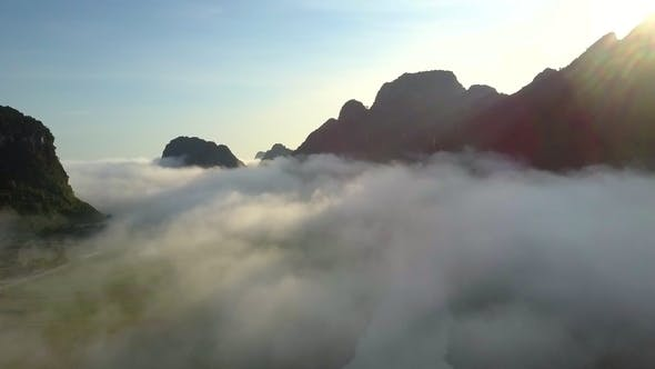Thumbnail for Along River Hidden By Fog Against Hills and Sky