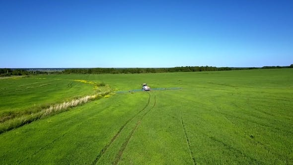 Thumbnail for Flycam Follows Tractor Trace on Vast Green Field