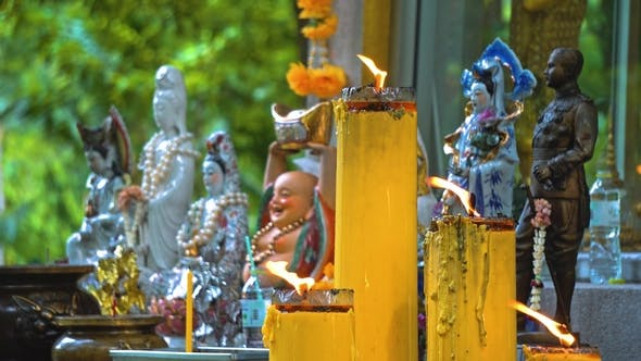 Thumbnail for Temple Buddha Under the Trees. Buddhism in Asia. Candles and Flowers. Place of Religious