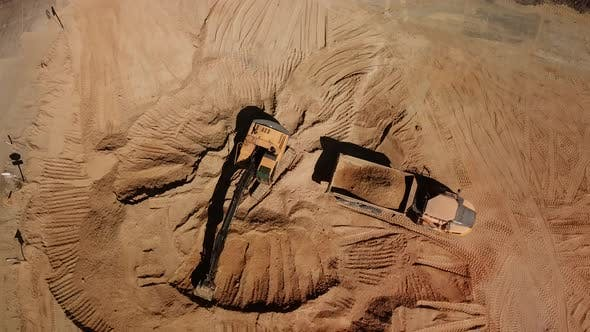 Thumbnail for Top Down View of Excavator Working in Construction Site