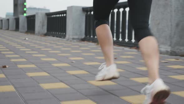 Thumbnail for Running woman. Female jogging fast along city bank