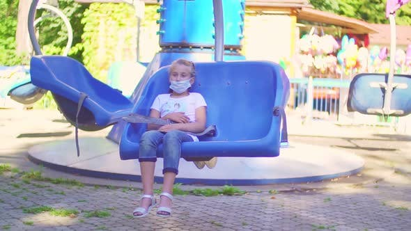 Girl Wearing a Protective Mask Sitting