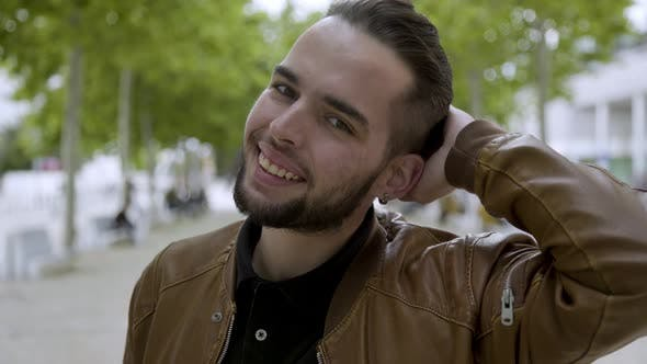 Thumbnail for Smiling Stylish Bearded Guy with Piercing Looking at Camera