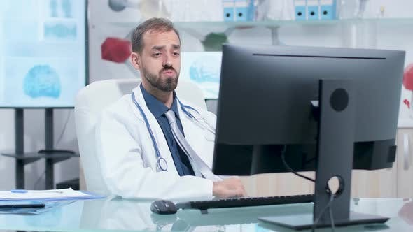 Thumbnail for Scientist Having a Video Call in His Modern Research Center