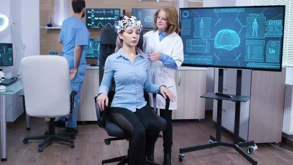 Thumbnail for Woman Wearing Brainwave Scanning Headset Sitting on a Chair