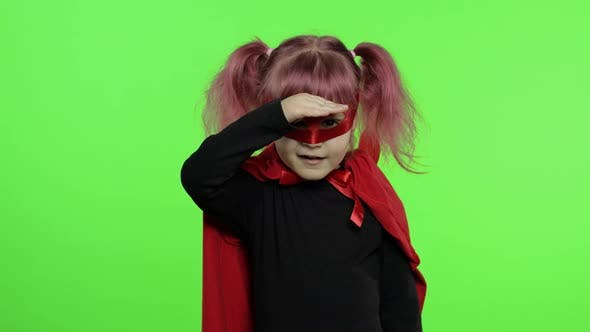 Thumbnail for Funny Child Girl in Costume and Mask Plays Super Hero. National Superhero Day