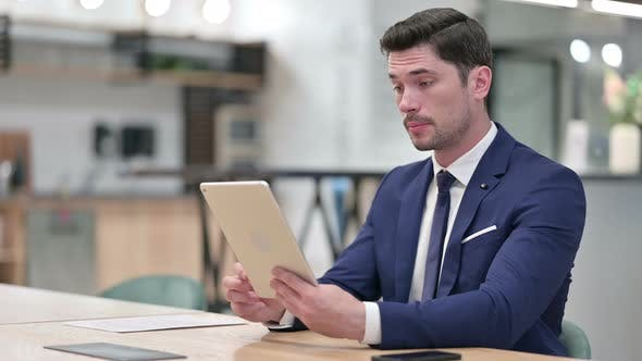 Professional Businessman Doing Video Call on Tablet