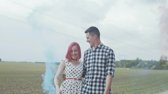 Thumbnail for Happy Couple Showing Smoke Heart in Countryside
