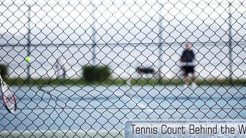 Tennis Court Behind The Wires