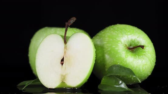 Thumbnail for Rotating Fresh Green Apples with Water Drops.