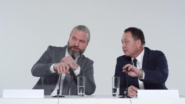Two Politicians Presenting Campaign at Press Conference
