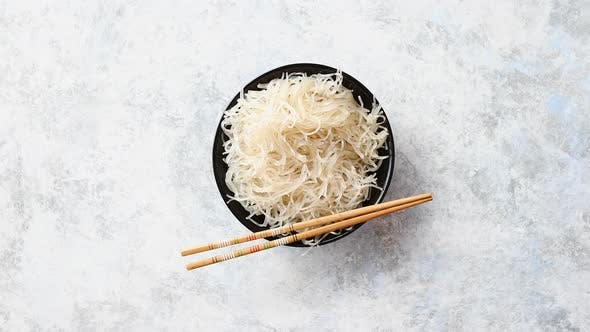 Thumbnail for Close Up of Bowl of Noodles with Wooden Chopsticks