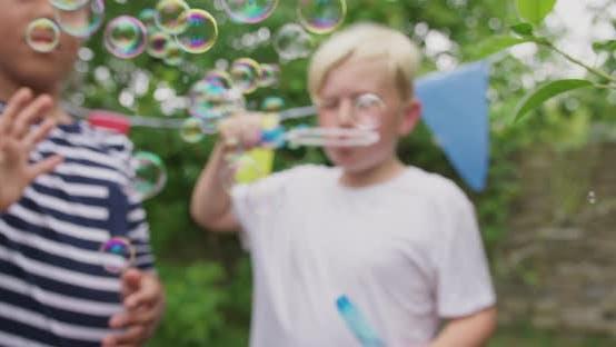 Thumbnail for Boys blowing bubbles