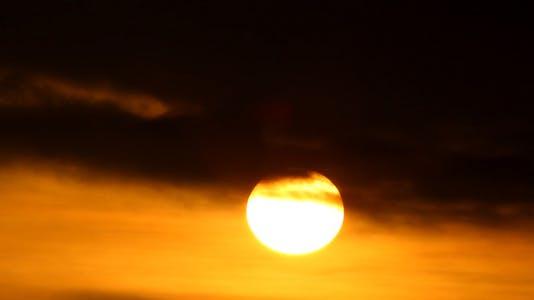 Sunrise Into Dark Cloud