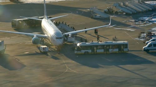 Passengers Exit From Plane