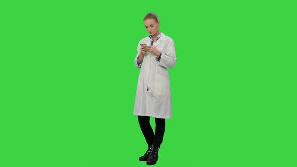 Thumbnail for Female Doctor Text a Message Using Modern Smartphone on a Green Screen, Chroma Key.