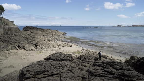 Thumbnail for Young Man Walking On The Stony Shore