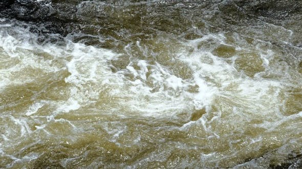 Thumbnail for Surface of a shallow fast flowing stream swirling over
