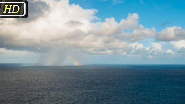 Thumbnail for Raining Cloud and Rainbow over the Ocean