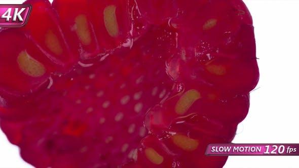Thumbnail for Squeeze Half Of Juicy Raspberries
